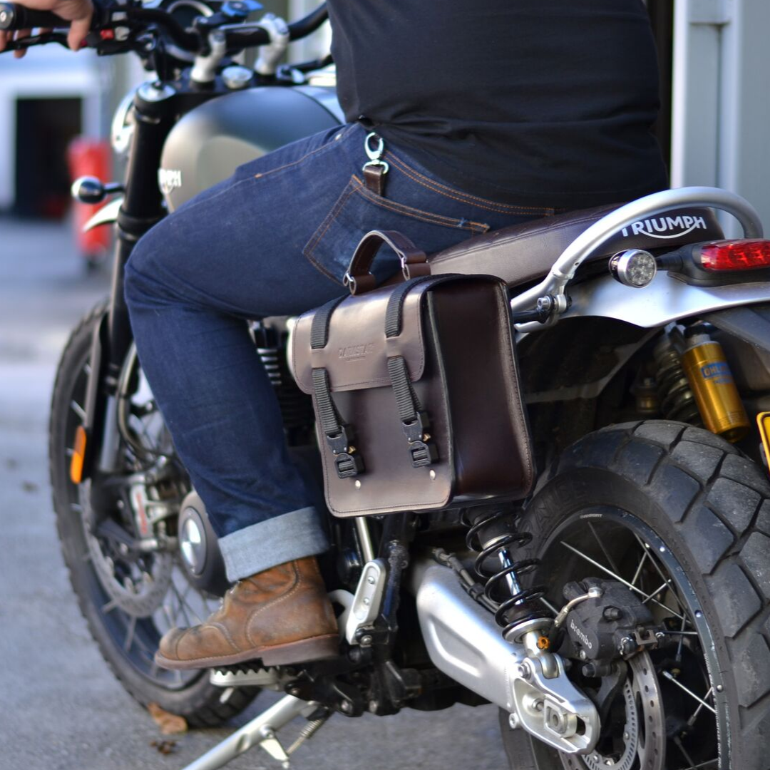 Nomad pannier on Triumph with rider.png